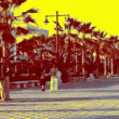 Walking along the broadwalk at valencia's beach - Stockfoto