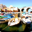 Boats and yachts moored in the picturesque Vallon des Auffes harbour — Stock Video #19067375