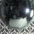 Stock Video: Funky discoball spinning with retro wallpaper background