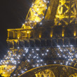 Eiffel tower lit up at night — Stock Photo #30830011