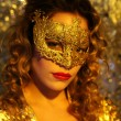 Dancing woman with gold mask — Stockfoto