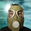 Stock Photo: Womwearing gas mask