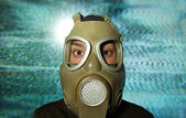 Woman wearing gas mask — Stockfoto