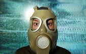 Woman wearing gas mask — Stock fotografie