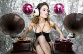 Beautiful disco DJ with gramophones — Stok fotoğraf