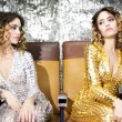 Beautiful disco twins i golden and silver catsuit — Stock Photo #42361259