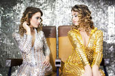 Beautiful disco twins i golden and silver catsuit — Foto Stock