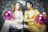 Two beautiful sexy disco women — Stockfoto