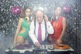 Grandpa DJ and two beautiful gogo dancers — Stock Photo