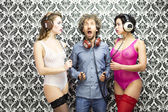 Man with 2 disco dancers — Stock Photo