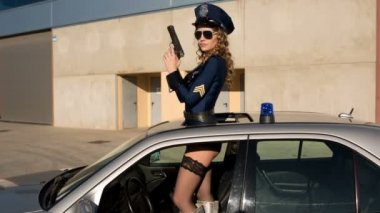 Dancing sexy police woman — Stock Video
