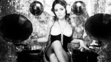 Female DJ in lingerie with vintage gramophones — Stock Video