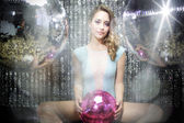 Beautiful sexy disco dj woman in lingerie surrounded by discobal — Stok fotoğraf