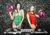 Two beautiful sexy disco dj women in bikinis performing in a clu — Stock Photo