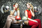 Sexy twins talking on phone — Stock Photo