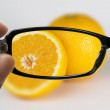 Eyeglasses looking for orange — Stock Photo