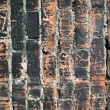 Blackened Charred brick wall background — Stock Photo