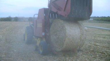 Round Baler at Dusk — Stock Video