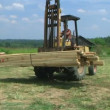 Stock Video: Forklift Unloading Construction Lumber