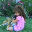 Girl Hugging Dog and Smiling — Stock Video #14513203