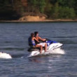 Stock Video: Young Couple On Jet Ski