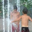 Kids Playing in Fountain - Stock Photo