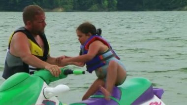Daughter Getting Off Jet Ski — Stockvideo