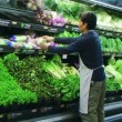 Stock Video: MFacing Vegetables In Produce