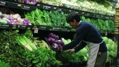 Man Facing Lettuce In Produce — Stock Video