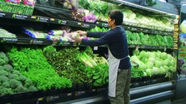 Man Facing Vegetables In Produce — Stock Video