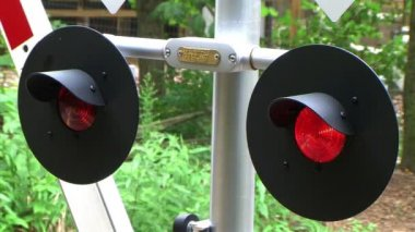 Flashing railroad crossing signal with barriers going down, with external audio.