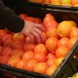 Woman Selecting Oranges In Produce — Stock Video #14556263