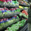Stock Video: WomStocking Lettuce In Produce