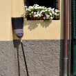 Broom propped against wall — Stock Photo #13985894