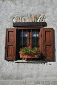 Window of an alpine house — Stock Photo