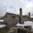 Stock Photo: Rests of military barracks in mountain over col du Mont Ceni