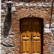 Stock Photo: Brown wood old door and street lamp
