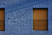 Yellow window in light blue wall in the centre of la boca — Stock Photo