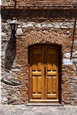 Brown wood old door and a street lamp — Stock Photo
