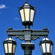 Old green street lamp and parrot — Stock Photo