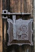 Metal lock screw and wood — Stock Photo