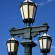 Old green street lamp and clouds — Stock Photo