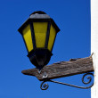 Street lamp and a wall in colonia del sacramento - Stock fotografie