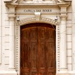 Brown wood old door of a church capilla san roque - Stock Photo