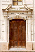 Brown wood old door of a church capilla san roque — Stock Photo