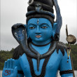 Foto Stock: Blue wood statue of Hinduism