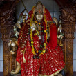 Foto de Stock  : Precious stone wood statue of Hinduism women