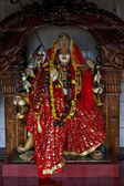 Precious stone wood statue of a Hinduism women — Stock Photo