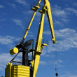 Stock Photo: House sky clouds and crane