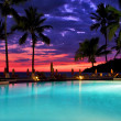 Stock Photo: Swimming pool sunset in nosy be
